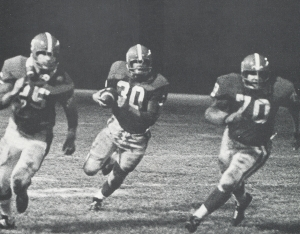 JIM CORLEY AND JOEY TINSLEY LEADING HAL BISSEL DOWN THE FIELD.(Click to enlarge.)